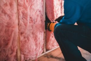 Person working on pink Insulation
