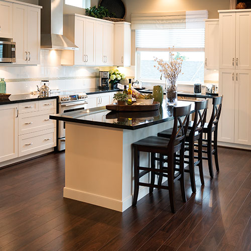 kitchen with black countertops and white cabinets remodeled by contractors in portland