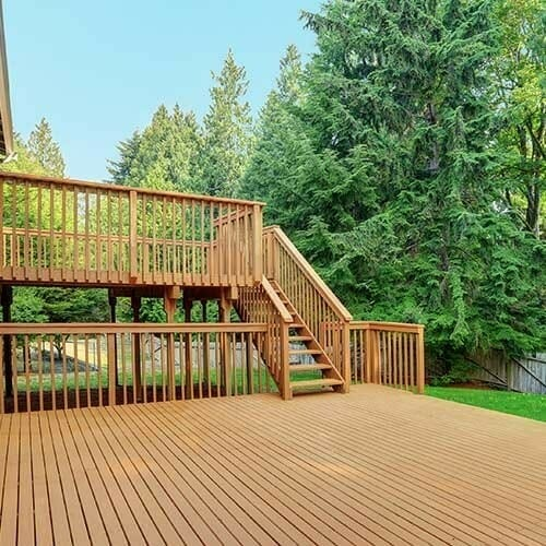 brand new empty deck with stairs to the second floor