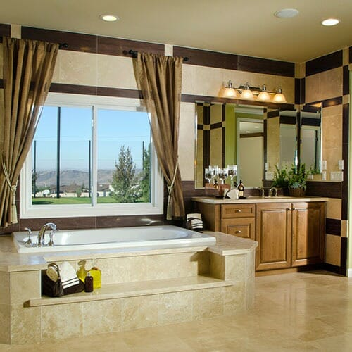 remodeled bathroom with tile steps to the tub