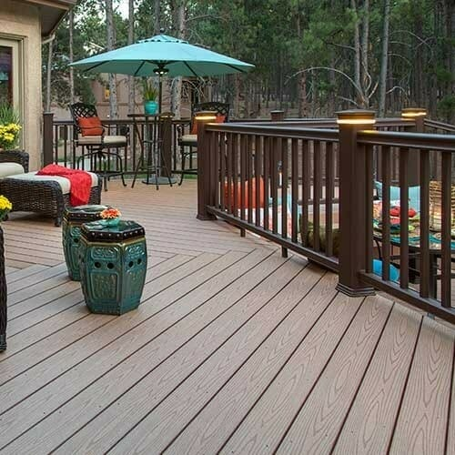 remodeled dark home deck with a blue umbrella